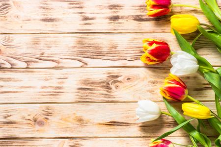 Tulips on wooden table. Flower background. 版權商用圖片