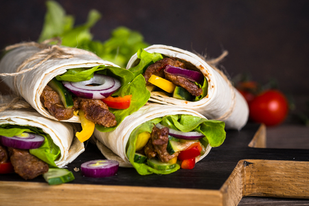 Burritos tortilla wraps with beef and vegetables. Stock Photo