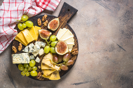 Cheese plate with grapes, figs and nuts. 写真素材