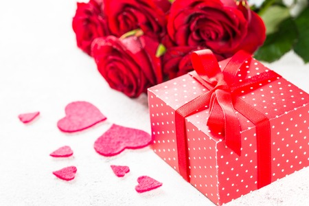 Valentines day background. Red roses, hearts and present on white. Stock Photo