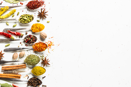 Set of various spices in spoons on white Imagens