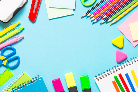 School and office supplies on blue background.
