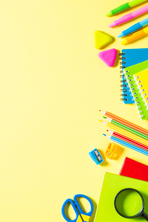 School and office sstationery on yellow background.