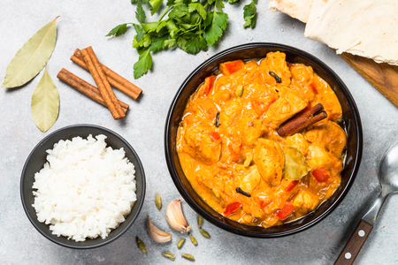 Chicken tikka masala with rice top view.