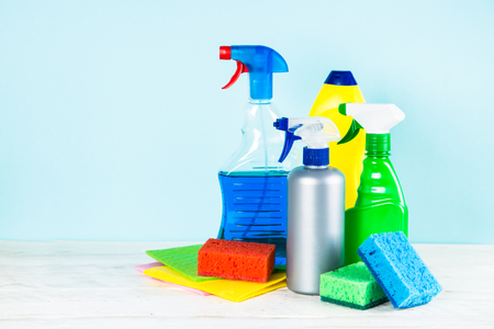 Cleaning product, household on blue background.