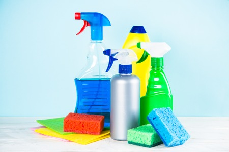 Cleaning product, household on blue background. Stock Photo