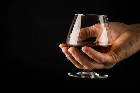 Cognac or brandy and chocolate. Фото со стока