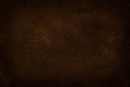 Brown texture dark slate background.