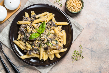 Pasta with mushrooms and spinach. Stock Photo