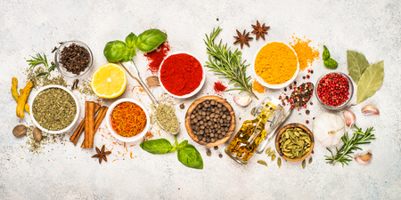 Set of various spices and herbs top view.