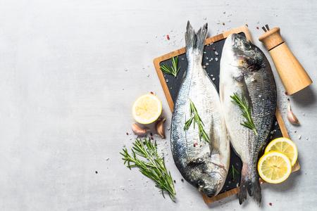 Fresh fish dorado on blue background.