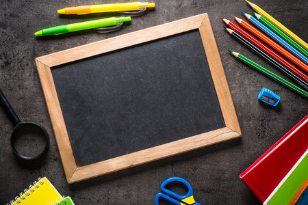 School and office stationery on black background.