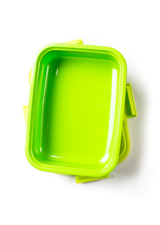 Green lunch box on white.