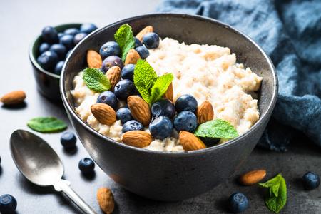 Oatmeal porridge with fresh berries and nuts.