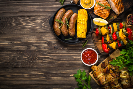 Barbeque dish - Grilled meat, fish, sausages and vegetables. Stock Photo