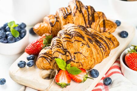Croissant with chocolate and fresh berries.