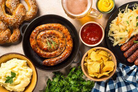 Oktoberfest food - sausage, beer and bretzel. Stock Photo