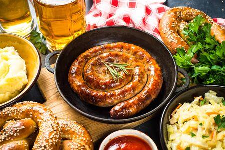 Oktoberfest food. Sauerkraut, sausage, pretzel, mashed potato and beer.