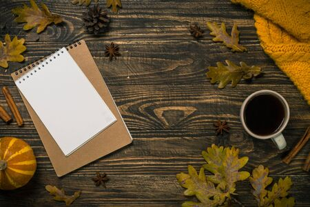 Autumn flat lay background on wooden table.