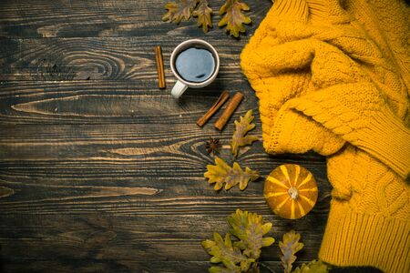 Autumn flat lay background with coffee, knitwear and yellow leaves. Stok Fotoğraf