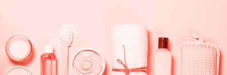 Spa product sets on pink background.