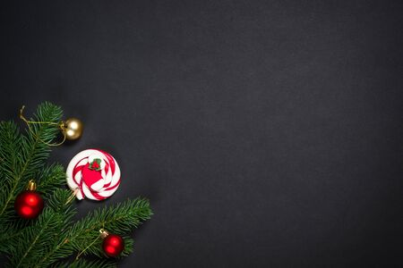 Christmas background with decorations on black.