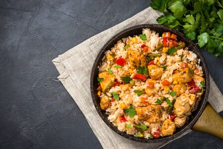 Rice with chicken and vegetables top view.