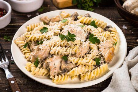 Pasta fusilli with Chicken and mushrooms In cream sauce.