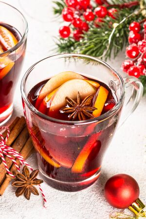 Mulled wine with christmas decorations on white. Stockfoto