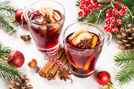Mulled wine with christmas decorations on white. Reklamní fotografie