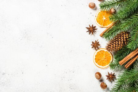 Christmas baking background with spices on white.