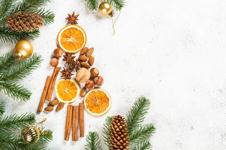 Christmas fir tree made from spices on white.