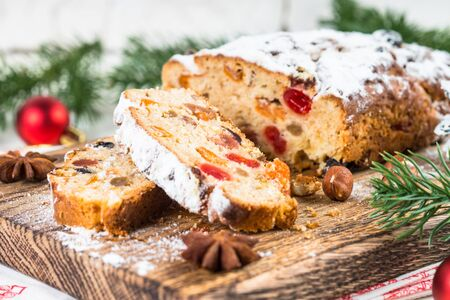 Stollen traditional Christmas fruitcake with dried fruit and nut