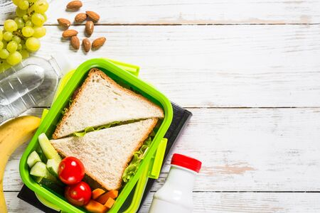 Lunch box with sandwich, vegetables, yogurt, nuts and berries. Stockfoto