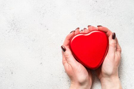 Red heart on white table top view. Stock Photo - 137500817