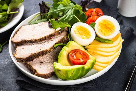 Keto diet plate on black stone table.