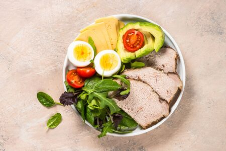 Keto diet plate on white table.