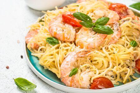 Pasta seafood with shrimp on white table. Archivio Fotografico
