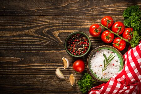 Food cooking background on wooden kitchen table.