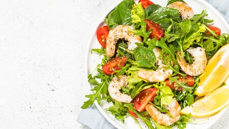 Shrimp salad with vegetables and leaves.