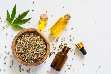 Cannabis oil and cannabis seeds at white. Stock Photo