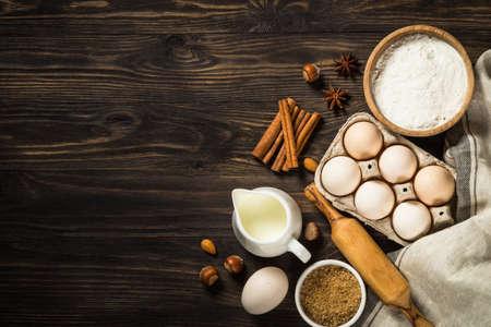 Baking ingredients on kitchen table. Stock fotó
