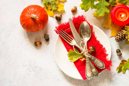 Autumn table setting top view at white table. Imagens