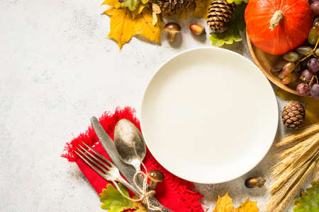 Autumn table setting top view at white table.