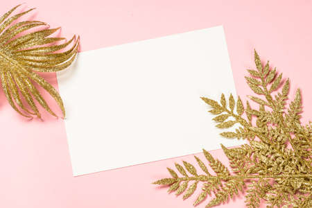 Christmas pink flat lay background with present box and decorations.