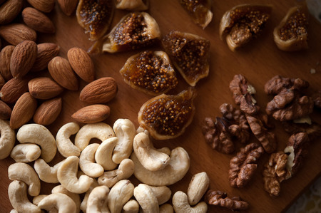 whole pecans: dried fruits - cashews, figs, almonds, walnuts Stock Photo