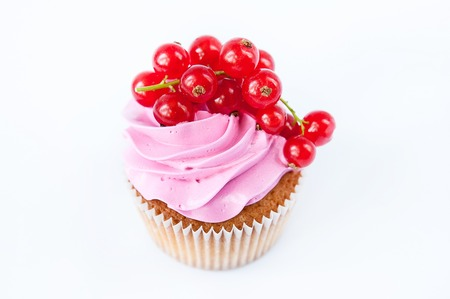 red currant: Cupcakes ( muffins ) with pink cream and red currant