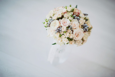 beautiful bridal bouquet in a vase of glass