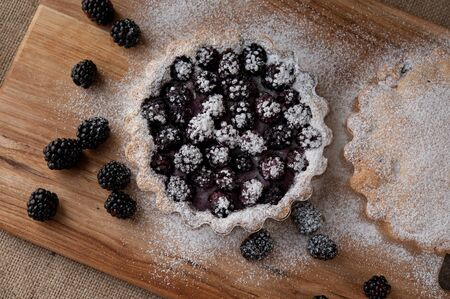 beautiful blackberry pie on a wooden table