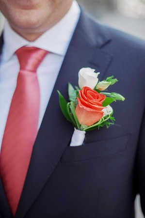 beautiful groom's boutonniere with roses